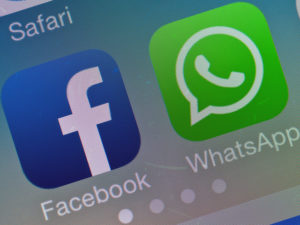 epa04090102 The two logos of Facebook (L) and Whatsapp pictured on the screen of a smartphone in Sieversdorf, Germany, 19 February 2014. Facebook announced on 19 February that it acquired the globally popular messaging system WhatsApp for 19 billion US dollar. Facebook paid 12 billion US dollar in shares and four billion US dollar in cash. The deal includes an additional three billion US dollar in Facebook stock for WhatsApp founders and employees. The deal should close later in 2014 and is still subject to regulatory approval, according to Facebook founder and Chief Executive Officer Mark Zuckerberg, who said in the conference call that he did not expect any issues. Additionally, WhatsApp co-founder and Chief Executive Officer Jan Koum will join the Facebook Board of Directors. EPA/PATRICK PLEUL